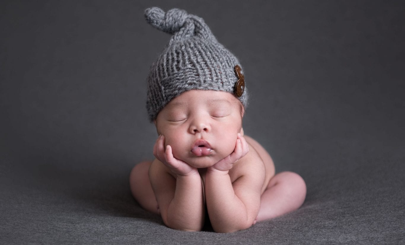 Newborn in a grey beanie by Savannah newborn photographer Truly Madly Deeply. Military family newborn photography session.
