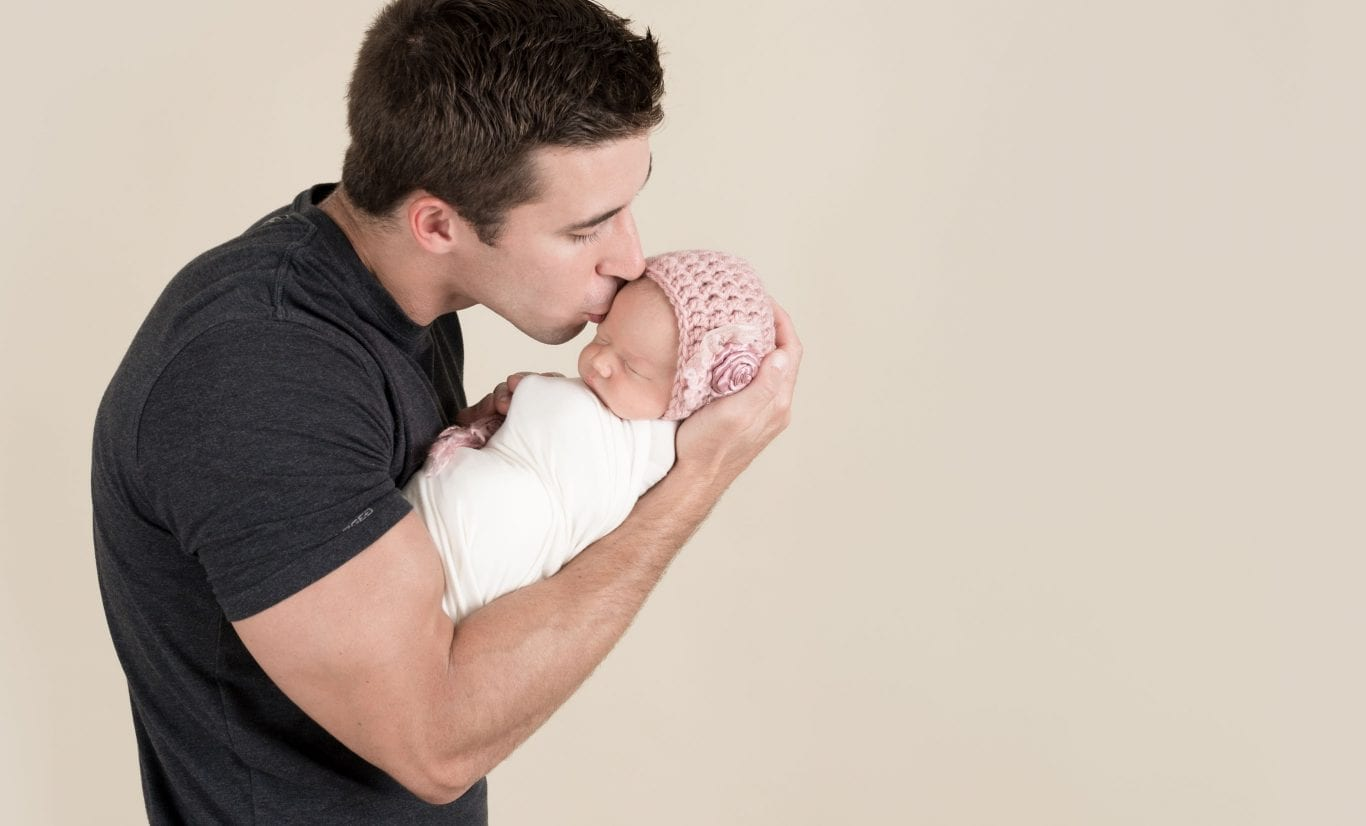 Dad with baby girl. Newborn photographer tips - How to prepare for your newborn's baby photo session with Truly Madly Deeply portrait, maternity and newborn photography studio in Savannah GA