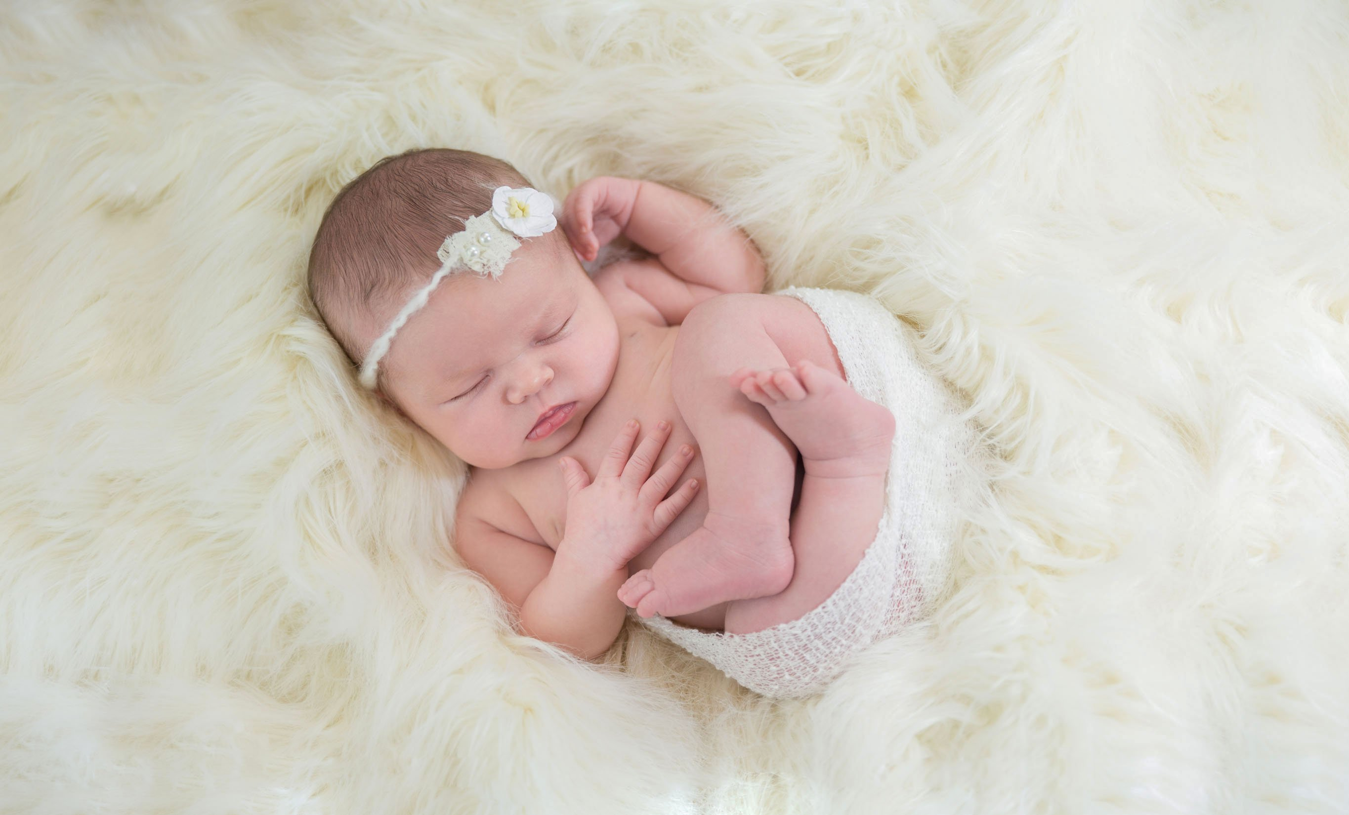 Professional newborn photography studio Truly Madly Deeply serving Melbourne, Titusville, Cocoa, Palm Bay, Brevard County, Florida's Space Coast, Orlando, Central Florida.